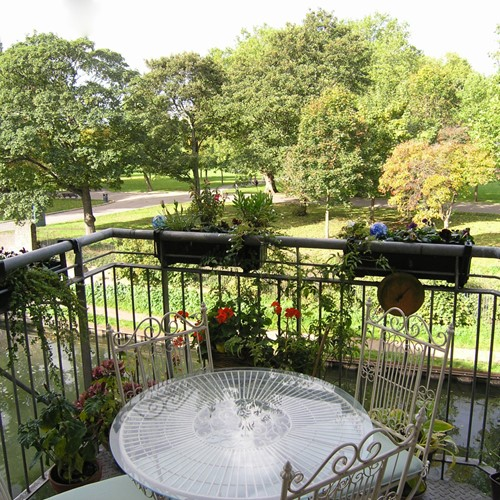 Lovely balcony overlooking a beautiful park