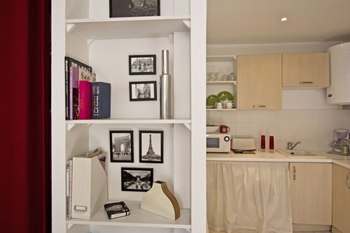 view to book shelf and kithen